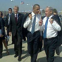 Prime Minister Benjamin Netanyahu and President Barack Obama talk at Ben Gurion Airport after Obama's arrival in Israel in March 2013. Michael Oren walks behind Obama (Via Facebook)