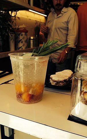 A refreshing glass of yellow cherry gazoz (Jessica Steinberg/Times of Israel)