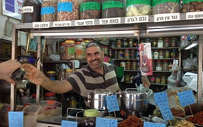 Serving up herbs for whatever ails you at Arama Spices in Levinsky (Jessica Steinberg/Times of Israel)