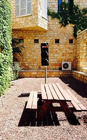 Fainaru's traffic light symbol, in a quiet courtyard of AMOCA's ecological home (Jessica Steinberg/Times of Israel)