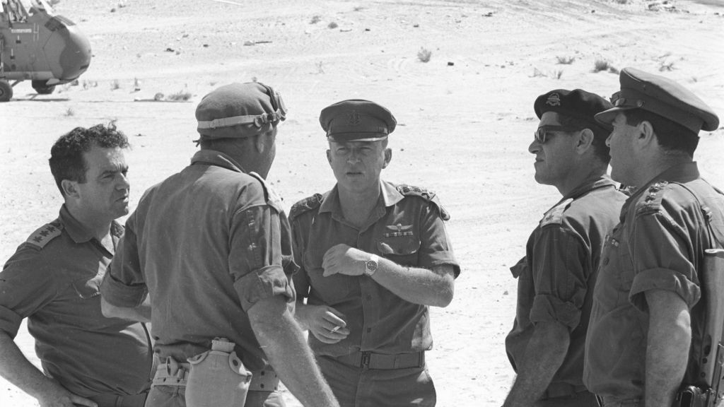 Yitzhak Rabin, center with cap, as Chief of IDF General Staff, during the Six Day War, speaking with the commander of the southern front Yeshayahu Gavish, opposite (Courtesy of Israel Defense Force Archive)