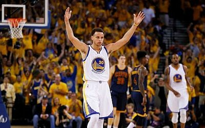 Stephen Curry of the Golden State Warriors celebrates during Game Two of the 2015 NBA Finals at ORACLE Arena in Oakland, California on June 7, 2015 (Ezra Shaw/Getty Images/via JTA)