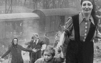 This 1945 photo of Bergen-Belsen inmates liberated from a train led to a search for the identities of the young girl and the woman whose hand she is holding. (Courtesy of George Gross/via JTA)