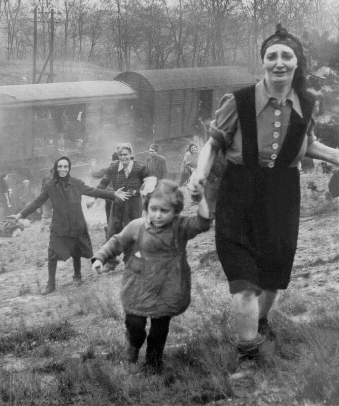 This 1945 photo of Bergen-Belsen inmates liberated from a train led to a search for the identities of the little girl and the woman whose hand she is holding. (Courtesy of George Gross)