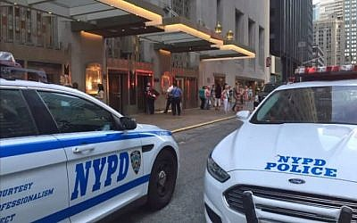 Police parked outside the Waldorf Astoria Hotel after a wedding guest accidentally sets off a gun, injuring a guest, June 13, 2015. (YouTube screenshot)