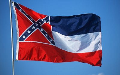 The flag of the state of Mississippi, with the Confederate banner in the corner (Shutterstock)