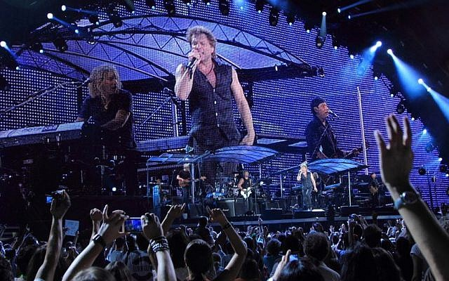 (The rock band Bon Jovi performing live at the Olympic stadium during the 2011 open air tour in Athens, July 20th 2011.  via Shutterstock)