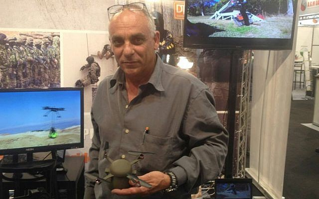 Mirom Kamay of SKK UAV with the still unnamed, palm-sized drone (Mitch Ginsburg/ Times of Israel)