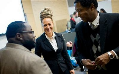 Rachel Dolezal (center), Spokane's NAACP president, meets with Joseph M. King, of King's Consulting (left), and Scott Finnie (right), director and senior professor of Eastern Washington University's Africana Education Program, before the start of a Black Lives Matter Teach-In on Public Safety and Criminal Justice, in Cheney, Washington, January 16, 2015. (Tyler Tjomsland/The Spokesman-Review via AP, File)