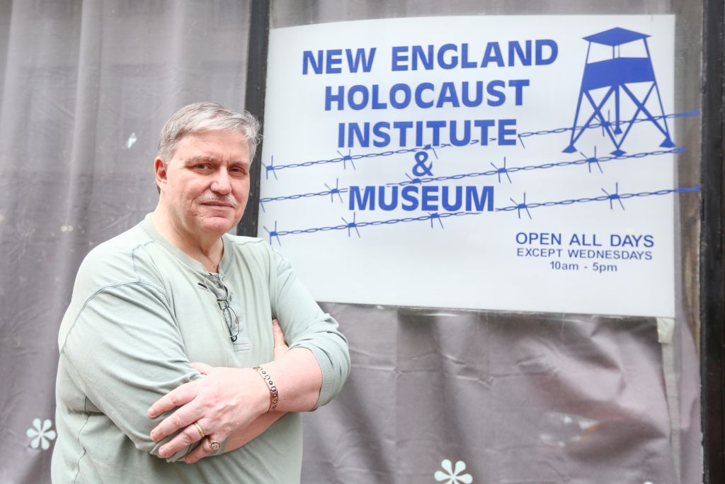 Seen outside the storefront of his recently shuttered New England Holocaust Institute in North Adams, Massachusetts, antiques collector Darrell English posed for a photo April 10, 2015 (photo credit: Elan Kawesch/The Times of Israel)