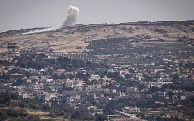 An explosion on the Syrian Golan Heights on June 16, 2015, as the al-Nusra Front fights against Assad's troops near the Syrian Druze village of Hader. (Basel Awidat/Flash90)