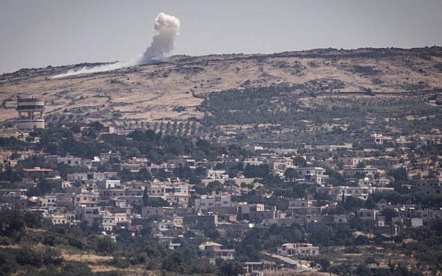 Illustrative: An explosion on the Syrian Golan Heights on June 16, 2015, as the al-Nusra Front fights against Assad's troops near the Syrian Druze village of Hader. (Basel Awidat/Flash90)