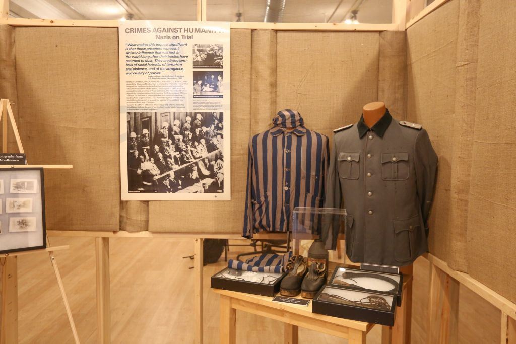 Uniforms and other artifacts from Nazi-era forced labor and death camps, collected and displayed by antiquarian Darrell English, founder of the Massachusetts-based New England Holocaust Institute & Museum (photo credit: Elan Kawesch/The Times of Israel)
