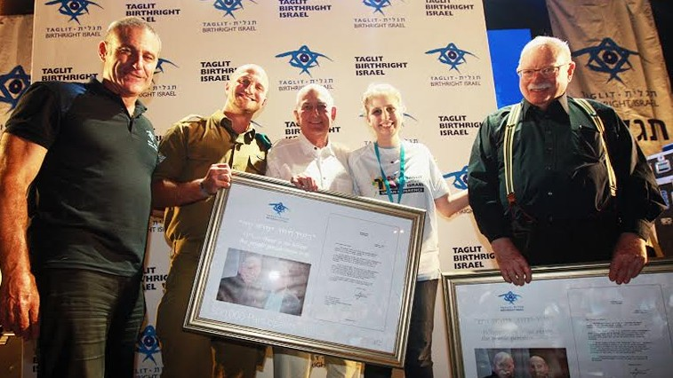 From left to right: Birthright CEO Gidi Mark; Staff Sgt. Shay Giladi, from the IDF Search and Rescue Unit; Charles Bronfman; Birthright's 500,000th trip participant Molly Dodd; and Michael Steinhardt. (Courtesy)