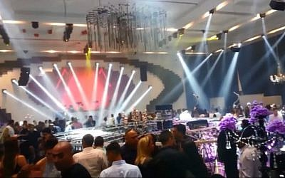 The ADIA event hall in Yavneh, moments after a lighting fixture collapsed at the scene, Tuesday, June 23, 2015 (screen capture: YouTube)