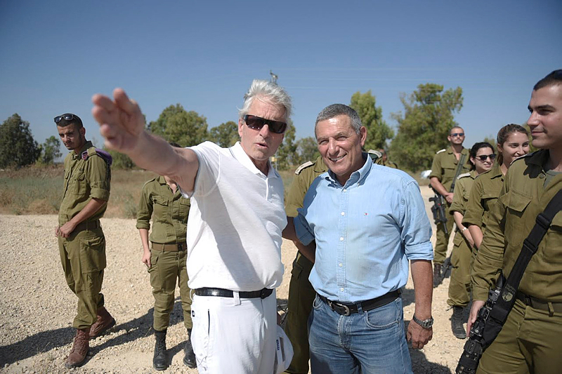 American Actor Michael Douglas takes part in a tour of a tunnel which was discovered before Operation Protective Edge, near the border with Gaza in southern Israel, during his visit to Israel, on June 16, 2015. (Israel Army Spokesperson)
