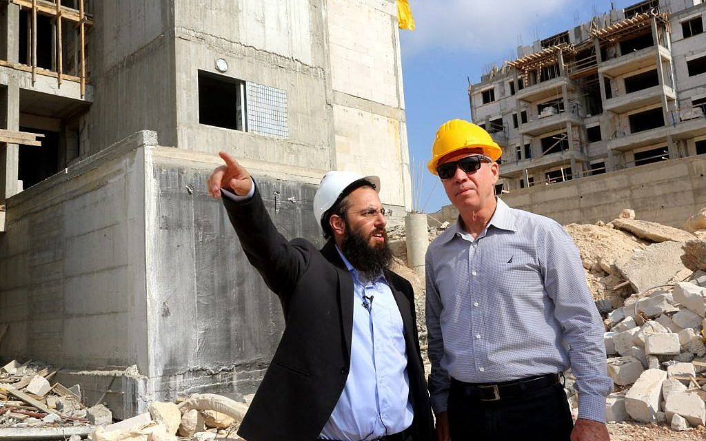 Yoav Gallant (right) inspects construction currently underway in the town of Harish, July 2, 2015. (Courtesy)