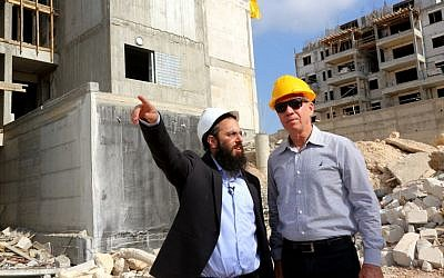 Yoav Galant (right) inspects construction currently underway in the town of Harish, July 2, 2015. (Courtesy)