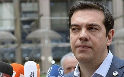Greek Prime Minister Alexis Tsipras talks to the media as he arrives for a meeting of the leaders of the 19 countries that use the euro, in Brussels on July 12, 2015. (AFP / THIERRY CHARLIER)