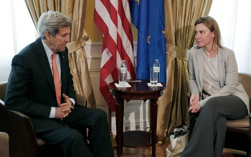 US Secretary of State John Kerry (L) meets with EU High Representative for Foreign Affairs and Security Policy Federica Mogherini at a hotel where the Iran nuclear talks are being held in Vienna, Austria on July 2, 2015. (Carlos Barria/AFP)