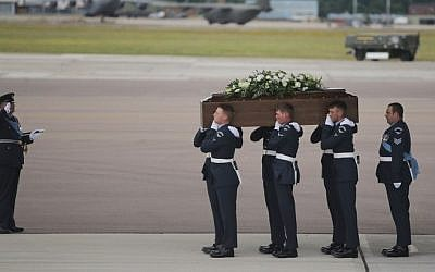 The coffin of Ann McQuire is taken from the RAF C-17 at RAF Brize Norton in Oxfordshire on July 2, 2015. The bodies of nine of the 30 British nationals killed in last week's Tunisia terrorist attack were returned on the flight. (AFP/Daniel Leal-Olivas)