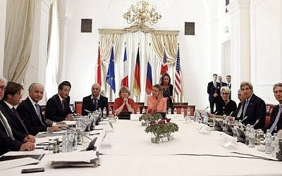 Foreign ministers sit around the table at the Palais Coburg Hotel, where the Iran nuclear negotiations were being held in Vienna, Austria on July 6, 2015.  (AFP/POOL/CARLOS BARRIA)
