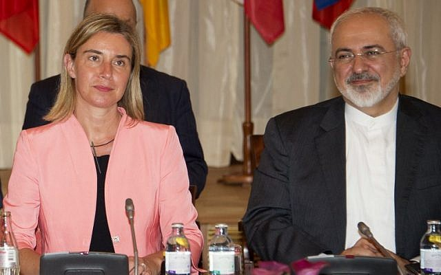 Federica Mogherini (L), High Representative of the European Union for Foreign Affairs and Security Policy, and Iranian Foreign Minister Mohammad Javad Zarif attend a meeting at the table at the Palais Coburg Hotel, where the Iran nuclear talks meetings are being held, in Vienna, Austria on July 6, 2015.  (AFP PHOTO / JOE KLAMAR)
