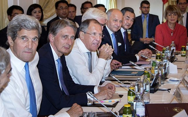 Left to right: US Secretary of State John Kerry, British Foreign Minister Philip Hammond, Russian Foreign Minister Sergey Lavrov, German Foreign Minister Frank-Walter Steinmeier, French Foreign Minister Laurent Fabius, China's Foreign Minister Wang Yi and EU Secretary General for the External Action Service, Helga Schmid, meet at the table at the Palais Coburg Hotel in Vienna, Austria, on July 6, 2015. (AFP/Joe Klamar)