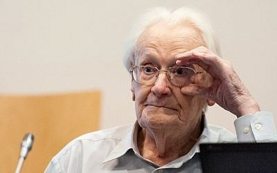 Defendant and German former SS officer Oskar Groening, 94, dubbed the 'bookkeeper of Auschwitz,' reacts at the courtroom in Lueneburg, northern Germany, ahead of his trial on July 7, 2015.  (AFP PHOTO / POOL/ PHILIPP SCHULZE)