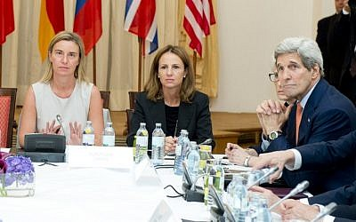 High Representative of the European Union for Foreign Affairs and Security Policy, Federica Mogherini (L) and US Secretary of State John Kerry (R) meet at the Palais Coburg Hotel, where the Iran nuclear talks meetings are being held, in Vienna, Austria on July 7, 2015.  (AFP PHOTO/JOE KLAMAR)