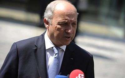 File: French Foreign Minister Laurent Fabius speaks to journalists in front of the Palais Coburg Hotel, where the Iran nuclear talks meetings are being held, in Vienna, Austria on July 7, 2015. (AFP PHOTO/SAMUEL KUBANI)