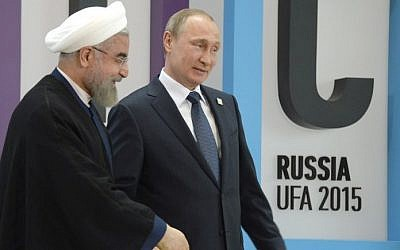 Russia's President Vladimir Putin (R) welcomes Iran's President Hassan Rouhani during the 7th BRICS summit in Ufa on July 9, 2015. (Alexander Nemenov/AFP)