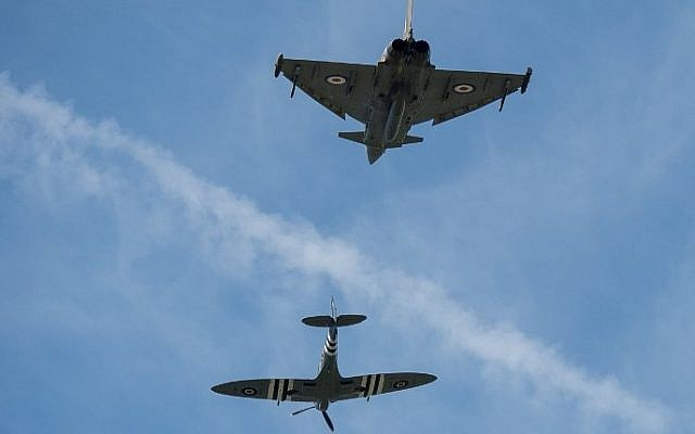 A Spitfire (bottom) flies with an RAF Typhoon over Buckingham Palace to mark the 75th anniversary of the Battle of Britain in London, on July 10, 2015 (Ben Stansall/AFP)