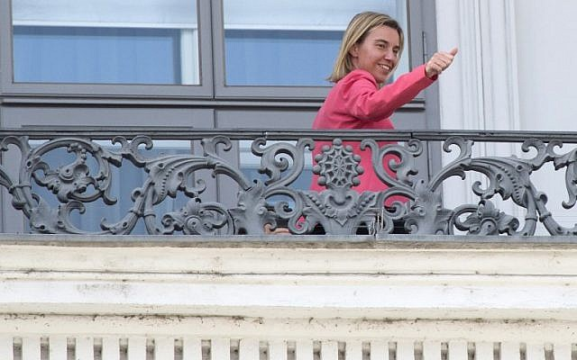 Federica Mogherini ,High Representative of the European Union for Foreign Affairs and Security Policy, gestures from the balcony of the Palais Coburg Hotel located at Theodor Herzl square where the Iran nuclear talks meetings are being held in Vienna, Austria on July 13, 2015. (AFP/JOE KLAMAR)