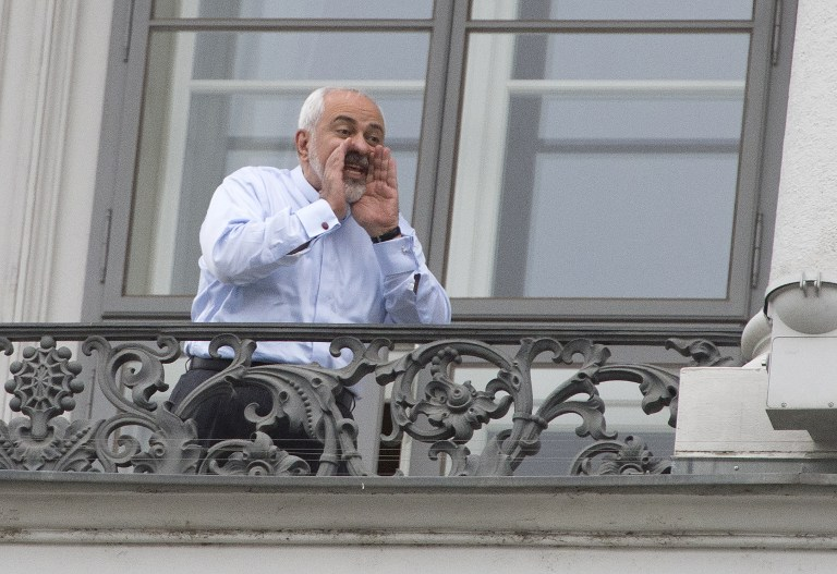 Iranian Foreign Minister Mohammad Javad Zarif Shouts From A Balcony Of The Palais Coburg Hotel Where