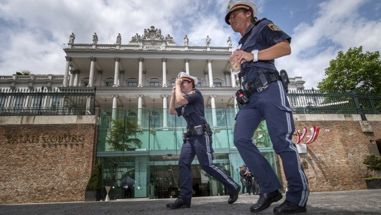 Austrian police officers walk past the Palais Coburg Hotel where the Iran nuclear talks meetings are being held in Vienna, Austria on July 13, 2015. (Joe Klamar/AFP)