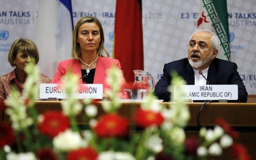 Iranian Foreign Minister Mohammad Javad Zarif (R) speaks next to European Union High Representative for Foreign Affairs and Security Policy Federica Mogherini (C) during a plenary session at the United Nations building in Vienna, Austria July 14, 2015. (Carlos Barria/AFP)