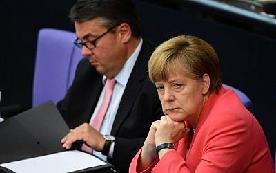 German Chancellor Angela Merkel (right) and Economy Minister Sigmar Gabriel (left) listen to a debate in the Bundestag, the German lower house of parliament in Berlin, on July 17, 2015. (John McDougall/AFP)