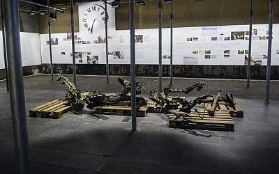 The remaining parts of the car used by Anders Behring Breivik are displayed in the government quarter in Oslo, Norway, on July 21, 2015 (AFP PHOTO / NTB SCANPIX / Fredrik Varfjell)