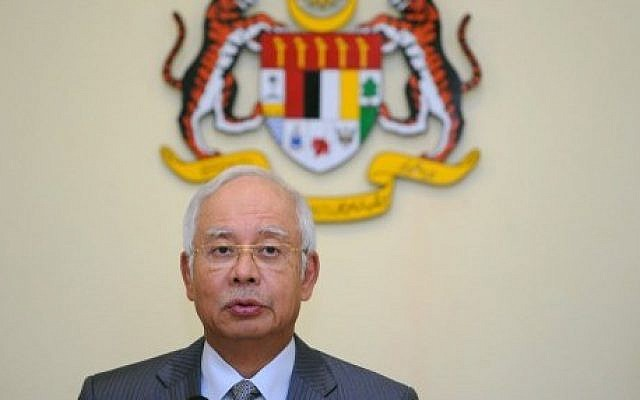 Malaysia's Prime Minister Najib Razak addresses a press conference at the Prime Minister's office in Putrajaya on July 28, 2015. (AFP/MOHD RASFAN)