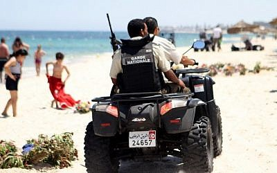 Tunisian security forces patrol a beach in Sousse, south of the capital Tunis, on July 1, 2015, as Tunisia started deploying armed police around tourist sites following last week's massacre in Port El Kantaoui by a jihadists gunman. (AFP /BECHIR TAIEB