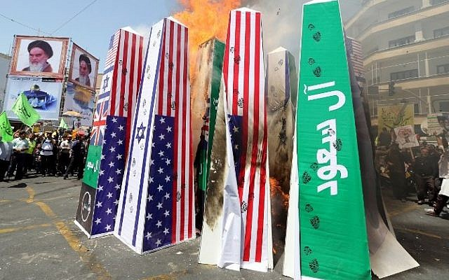 Iranian protesters burn Israeli, US and Saudi Arabian flags during a demonstration to mark the Quds (Jerusalem) International day in Tehran on July 10, 2015. (AFP/ ATTA KENARE)