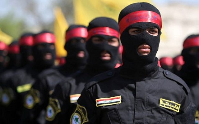 Iraqi members from the Popular Mobilisation units take part in a demonstration marking the Quds (Jerusalem) International day in the capital Baghdad, on July 10, 2015. (AFP/AHMAD AL-RUBAYE)