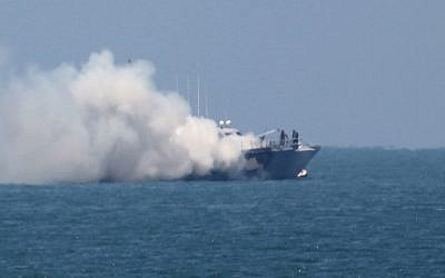 A picture shows smoke billowing from an Egyptian naval vessel on the maritime border between Egypt and the Gaza Strip on July 16, 2015.  (AFP/SAID KHATIB)