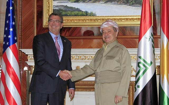 US Defense Secretary Ashton Carter (left) shakes hands with Massoud Barzani, president of the Kurdish regional government, in Arbil on July 24, 2015. (AFP/Gailan Haji)