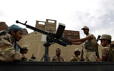 Houthi rebels ride in the back of a truck during a rally in the capital Sanaa on July 24, 2015. (AFP/Mohammed Huwais)