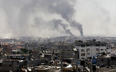 Smoke billowing following an IDF strike east of Rafah in the southern Gaza Strip, August 1, 2014. (AFP/SAID KHATIB/file)