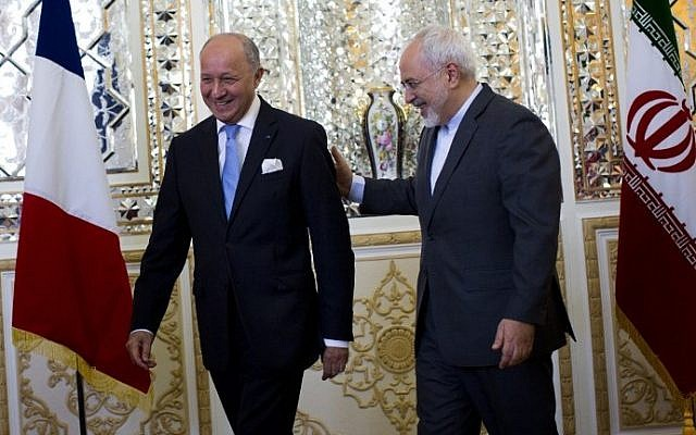 Iranian Foreign Minister Mohammad Javad Zarif (R) greets his French counterpart Laurent Fabius prior to their talks in Tehran on July 29, 2015. Iranian President Hassan Rouhani visits France during the last week of January 2016. (Behrouz Mehri/AFP)