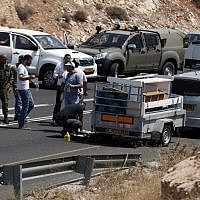 Israeli police investigate the scene of a shooting attack targeting an Israeli car on a road near the Kohav Hashahar settlement in the West Bank, July 31, 2015. (AFP Photo/ Thomas Coex)