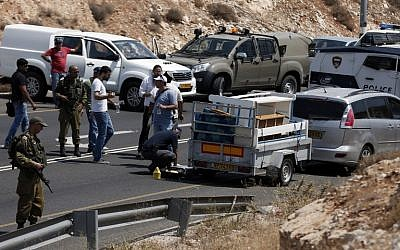 Illustrative of Israeli police investigate the scene of a shooting attack targeting an Israeli car on a road near the Kohav Hashahar settlement in the West Bank, July 31, 2015. (AFP PHOTO/THOMAS COEX)